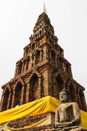 imbedded: Buddha Statue , Old Chedi in Wat  Phra That Hariphunchai