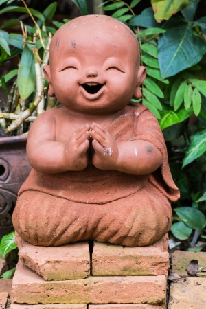 Doll clay monk used in Thailand photo