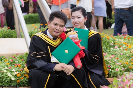 Young Thai man And Woman graduation photo