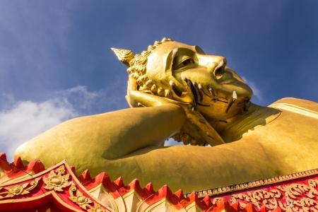 reclining: Big Reclining Buddha in Wat Mokkanlan , Chomthong Chiangmai Thailand Stock Photo