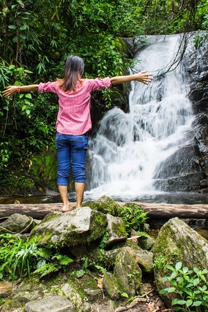 Thai Girl Relax At Siribhum Water Fall in Doi inthanon , Chiangmai Thailand photo