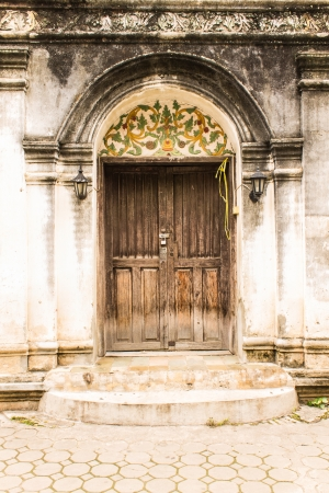 Shan style temple old door in Wat Papoa , Chiangmai Thailand photo