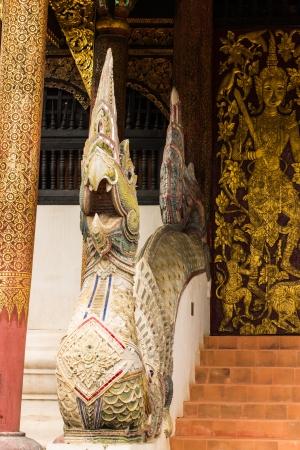 Naga Staircase And  old Ubosot Lanna Style in Wat Buak Krok Luang , Chiangmai Thailand photo