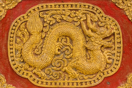 Naga Wall sculpture on Ubosot in Wat Saen Fang , Chiangmai Thailand photo