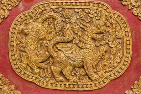 chiangmai: Singha Wall sculpture on Ubosot in Wat Saen Fang , Chiangmai Thailand