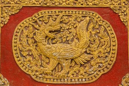 chiangmai: Naga Fusion Swan Wall sculpture on Ubosot in Wat Saen Fang , Chiangmai Thailand