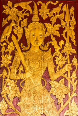 Ornament wooden door of Thai temple in Ubosot Wat Buak Krok Luang , Chiangmai Thailand photo