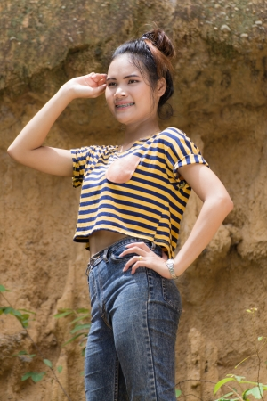 Thai Woman portrait standing near Cliff  photo