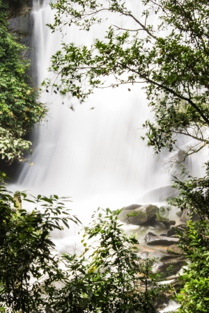 taking the plunge: wachirathan waterfalls , Inthanon Chiangmai Thailand Stock Photo