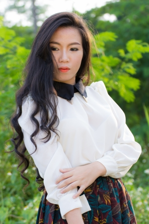 Profile of a young Asian woman photo