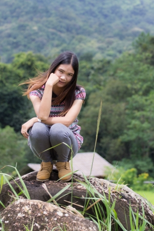 Thai Woman Enjoy on The rock in Field Doi inthanon, Maeglangluang Karen villages photo