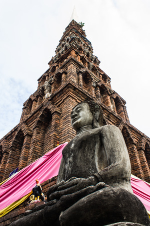 Buddha Statue And Old Pagoda, Wat Phra That Hariphunchai photo