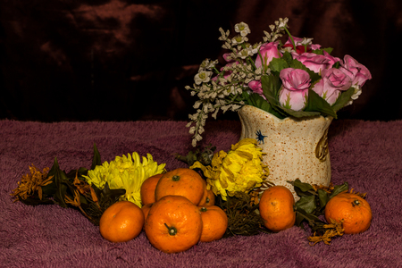 Still life - Tangerines , chrysanthemum withered And Plastic flower photo