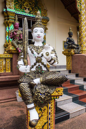 black giant mountain: Thai angels with swords in Temple Stock Photo