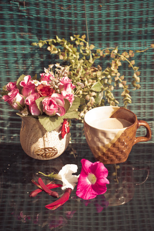 Still Life , Coffee Cup  With  Rose Plastic, flowers and Plant photo