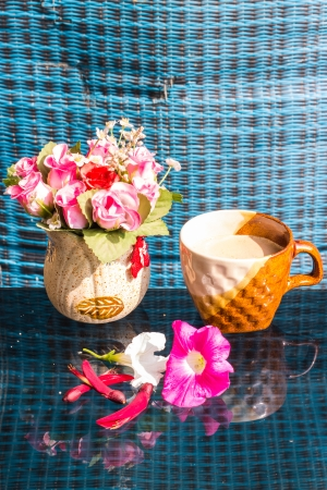 erythrina: Still Life , Coffee Cup  With  Rose Plastic, Erythrina variegata And Petunia flowers