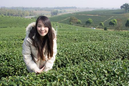 Portrait Thai woman in tea plantation , Chiangrai Thailand photo