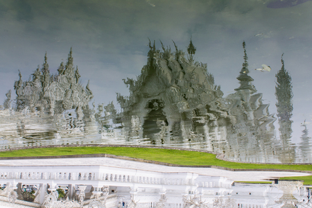 Shadows in the Water Of Wat Rong Khun , Thailand White Temple Chiang Rai Province photo