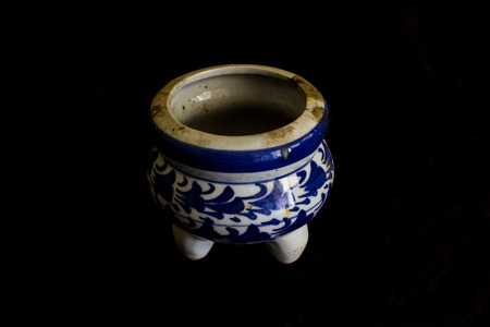 incense burner Ceramic isolated on black photo