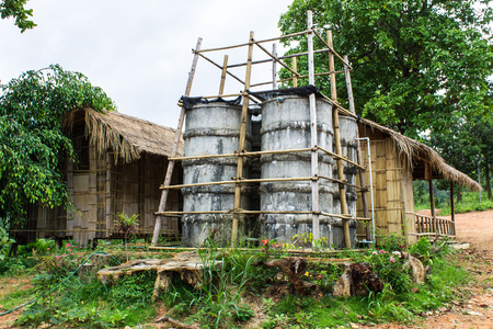 cement water tower, countryside in Thailand photo
