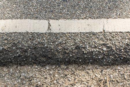 dashed: old asphalt roadside