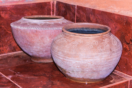 Clay pot on drinking water is the Thai way of life , lanna style photo