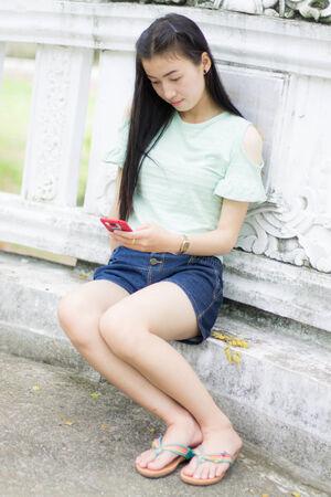 Portrait Beautiful asian woman with smart phone photo