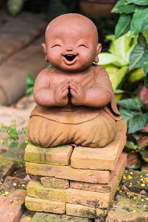 novice: smiling buddhist novice made of clay, Thai style