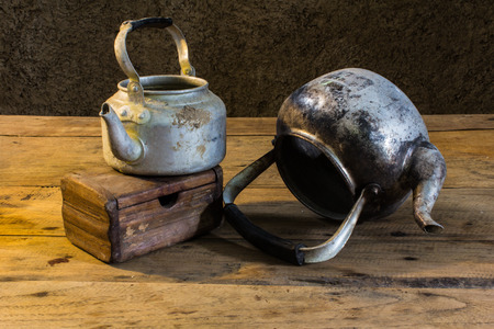 still life old classic kettle with Old chest photo