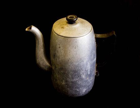 kettle on black background photo