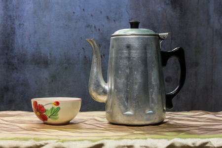 still life classic kettle with cup photo