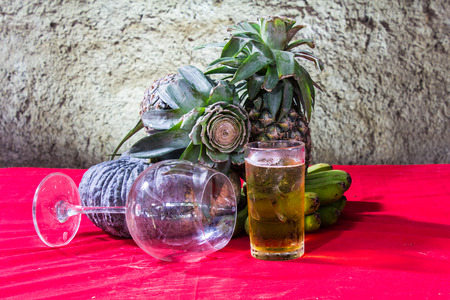 still life art photography on banana pumpkin glass beer and pineapple photo
