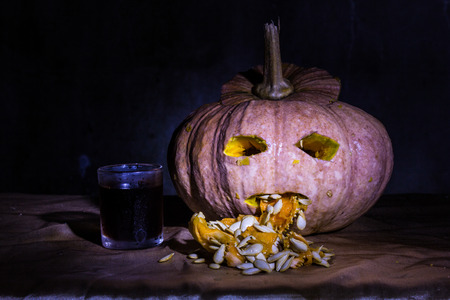 Haunted carved pumpkins for Halloween with liqueur photo