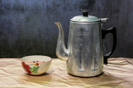 still life classic kettle with cup and lamp photo