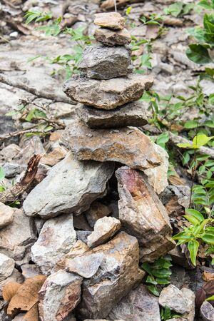 pyramid peak: stones stacked in forest, asia