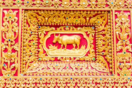 himmapan: cow Wall sculpture in Thai temple