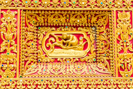 himmapan: monkey Wall sculpture in Thai temple Stock Photo