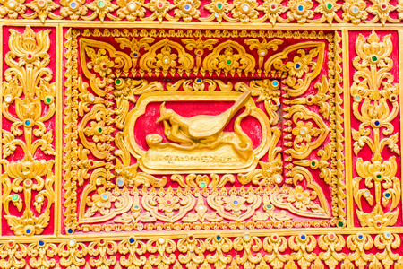 himmapan: Peacock Wall sculpture in Thai temple