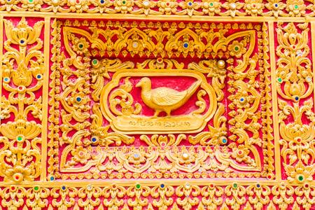 himmapan: bird Wall sculpture in Thai temple
