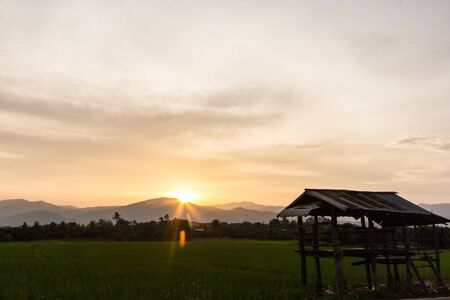 hogshead: old cottage in the rice fields with mountain Stock Photo