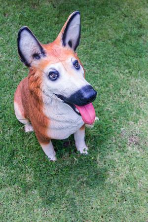 pensiveness: dog statue in lawn