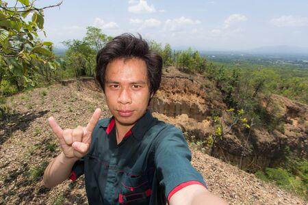 grand hard: Man Selfie with Doi Tok grand canyon in Mae Wang national park,