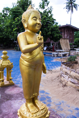 venerate: Golden child Buddha statue in Thailand temple Stock Photo