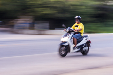 panning: Motorcycling Panning In Thailand, women Stock Photo