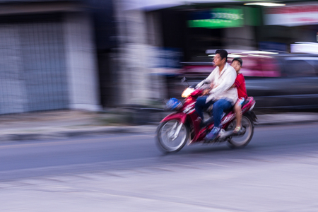motorcycling: Motorcycling Panning In Thailand, women Editorial