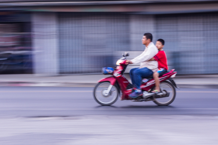 panning: Motorcycling Panning In Thailand, women Editorial