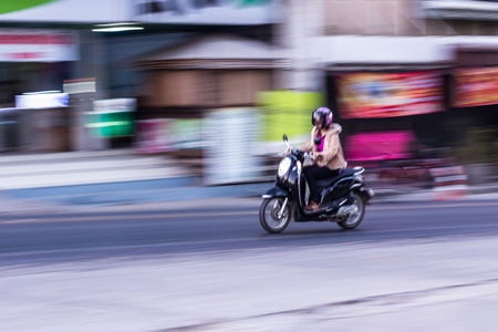 panning: motorcycle panning in road, Asia Stock Photo