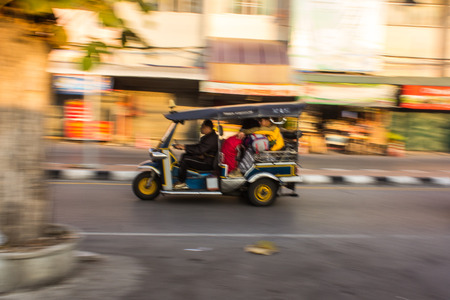 tuktuk: traditional tuk-tuk  Thailand, in motion blur