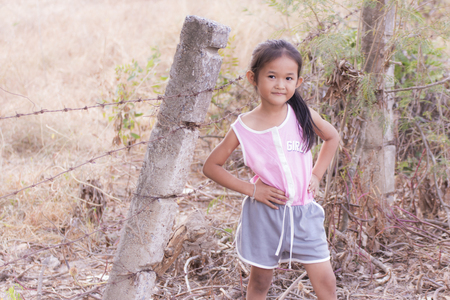 portarit: Portarit Thai little girl  with  barbed fence Stock Photo