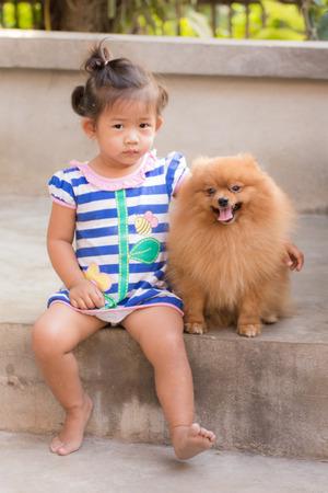 pomeranian: thai girl with pomeranian